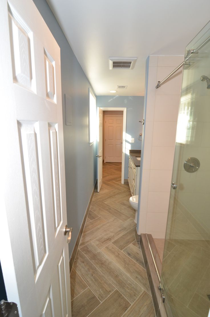 Full basement bathroom with walk in shower frameless glass for Walk in basement