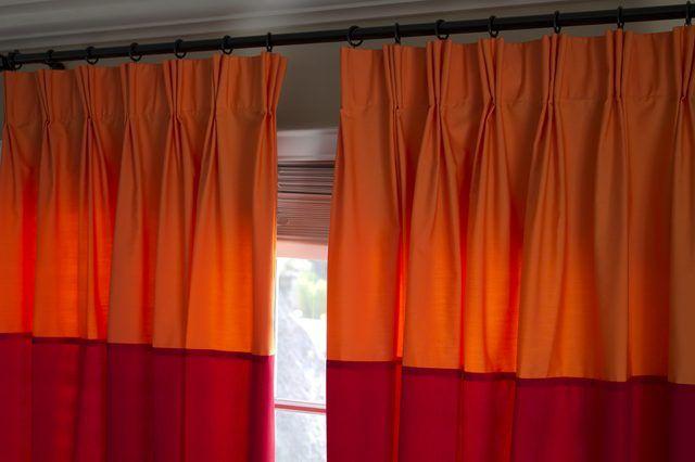 Elegant pinch pleat drapes.