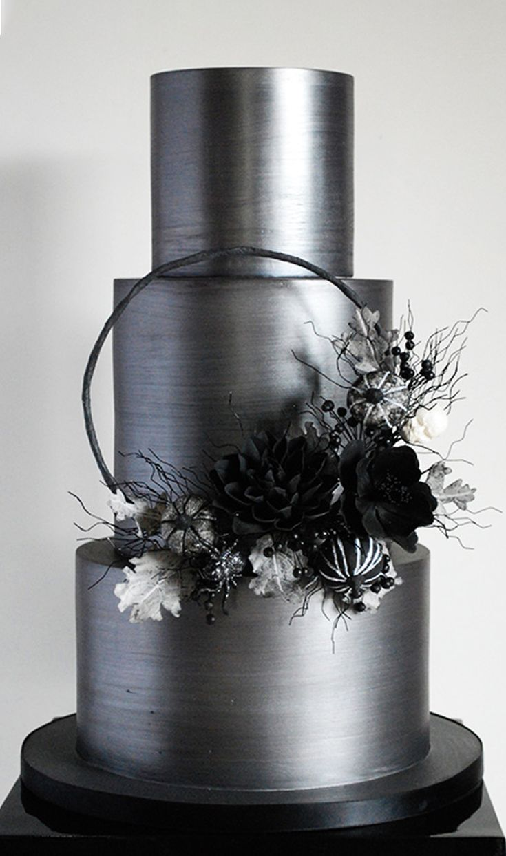This is one sexy, dark, shimmery wedding cake! I'm digging that gunmetal shine and the black and white sugar flower decor! #weddingcake #cake #decorating #shiny #metallic #black #white #silver #howto #tutorial
