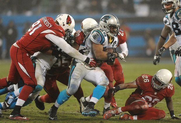 Carolina Panthers running back Jonathan Stewart (28) continues to fight for ground as the Arizona Cardinals defense looks to make the tackle during fourth quarter action on Saturday, January 3, 2015 in Charlotte, NC. The Panthers defeated the Cardinals 27-16 in NFL Wild Card action.