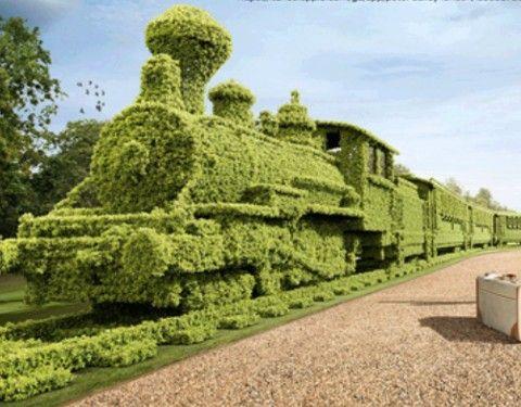 train and tracks bush sculpture