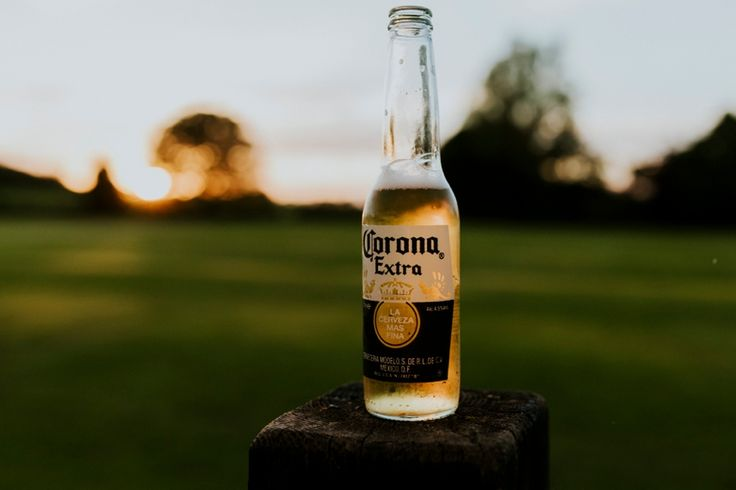 #corona Photo by Benjamin Stuart Photography #weddingphotography #beer #drinks #sunset #weddingparty