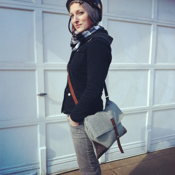 Pip Robins's owner shows off her latest and favorite piece from her collection of purses.