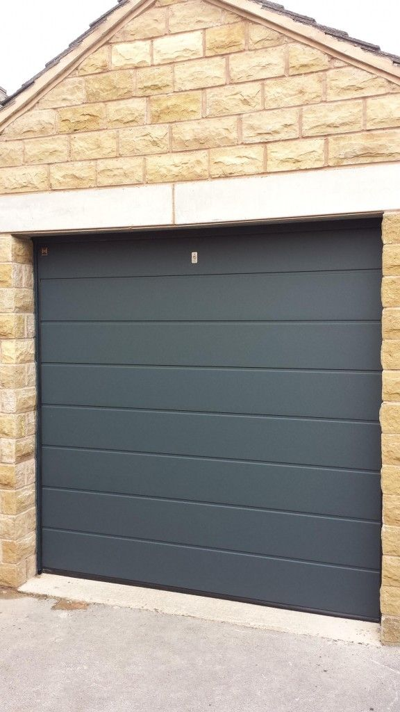 Hormann M Rib LPU40 Sectional Garage Door By ABi Hormann M Ribbed LPU40 made to measure insulated sectional garage door in Anthracite Grey Sand Grain.