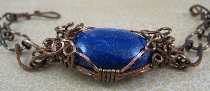 Lapis Lazuli cabachon wire wrapped bracelet.