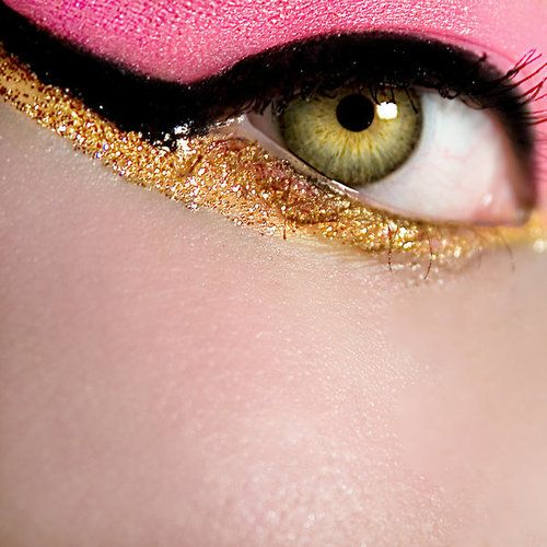 Bright Carnation Pink Eye Makeup Outlined in Black and Sparkling Metallic Gold