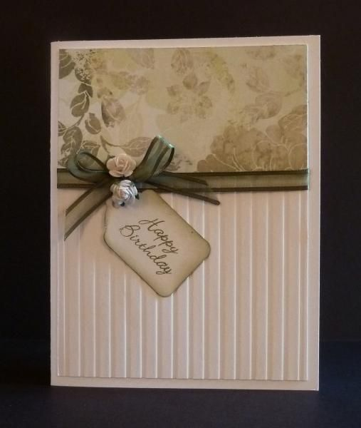 By Reddyisco at Splitcoaststampers. She may have stamped the top, or she may have used designer paper. The bottom is dry embossed. Add a ribbon & card base. Flowers & a tag finish the card.