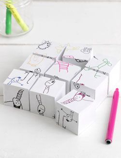 "kids drawings turned into puzzle blocks. I could make this from 6 pieces of kid art, scanned and cropped into a 9"" square, cut into 3"" squares, then glued onto 3"" cubes."