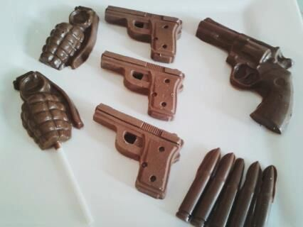Chocolate guns and grenades, handmade to order at www.cambridgechocolates.co.uk