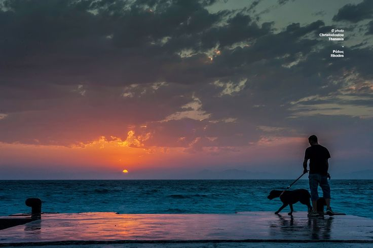 Photo taken by Thanasis Christodoulou. Sunrise at Rhodes, Greece. Man with his dog. #rhodes #sea #photography #landscape #beach #sunset #dogwalk #greece