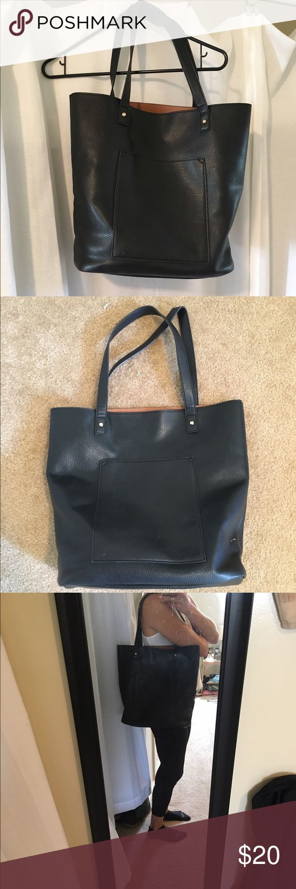 Large bucket black tote bag Large bucket black tote bag. Lightly used. Slight pen marks in inside, slight scuff on the side, and slight peeling on the handle. All pictured. Still in good condition! Offers welcome. Urban Outfitters Bags Totes