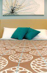 Bedspread in Acorn Coffee (Bathurst Heritage Motor Inn) #materialisedfabrics #fabricsfortherealworld #performancefabrics #hoteldesign
