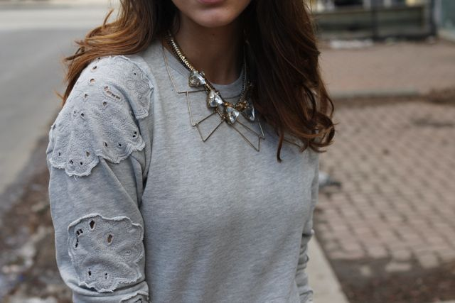 details of this sweatshirt and layered necklaces