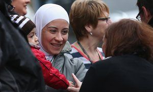 Refugees arrive on the Scottish Isle of Bute