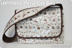 Well done tutorial on how to make this messenger bag. Looks like what she's calling laminated cloth is what I call oilcloth.