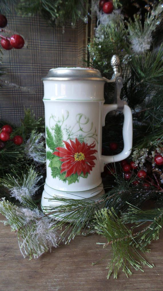 Beautiful German Christmas beer (or hot cocoa!) stein decorated with a poinsettia, greenery and Merry Christmas on the backside. Nice, heavy stein with lid. In wonderful vintage condition. No chips or cracks to mention. Well cared for. Please enlarge the photos to see all the