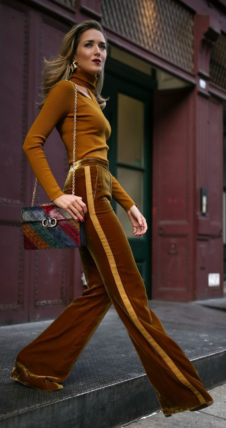 Velvet long sleeve turtleneck styled with velvet gold tuxedo striped wide leg trousers