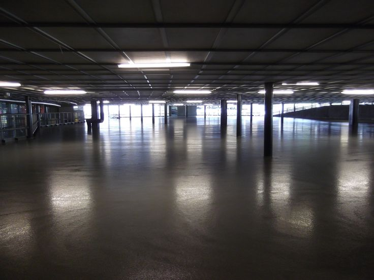 Rehabilitated undercover parkade floor after installation of industrial self-levelling screed