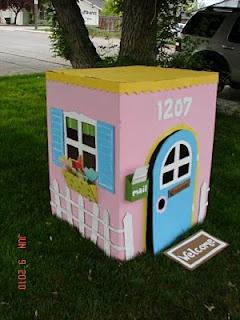 Cute homemade cardboard playhouse.