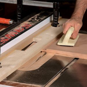 Phenolic plywood makes this jig slide smoothly over the tablesaw's rip fence