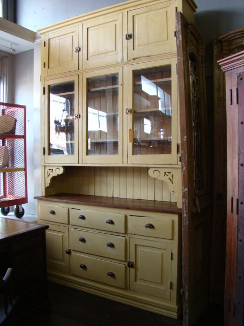 Free standing cupboard with beadboard, bin pulls, and glass doors
