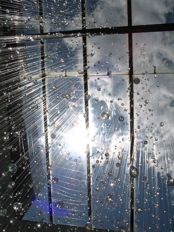 Rain is a 2005 installation of suspended glass water droplets by Chicago artist Stacee Kalmanovsky. She really found a perfect spot to install this, ...