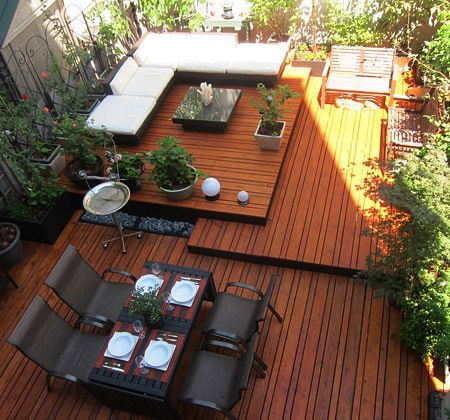 A courtyard with concrete slab floor was transformed from a dull and dreary outdoor area into a multi-level entertainment space. The entire ...