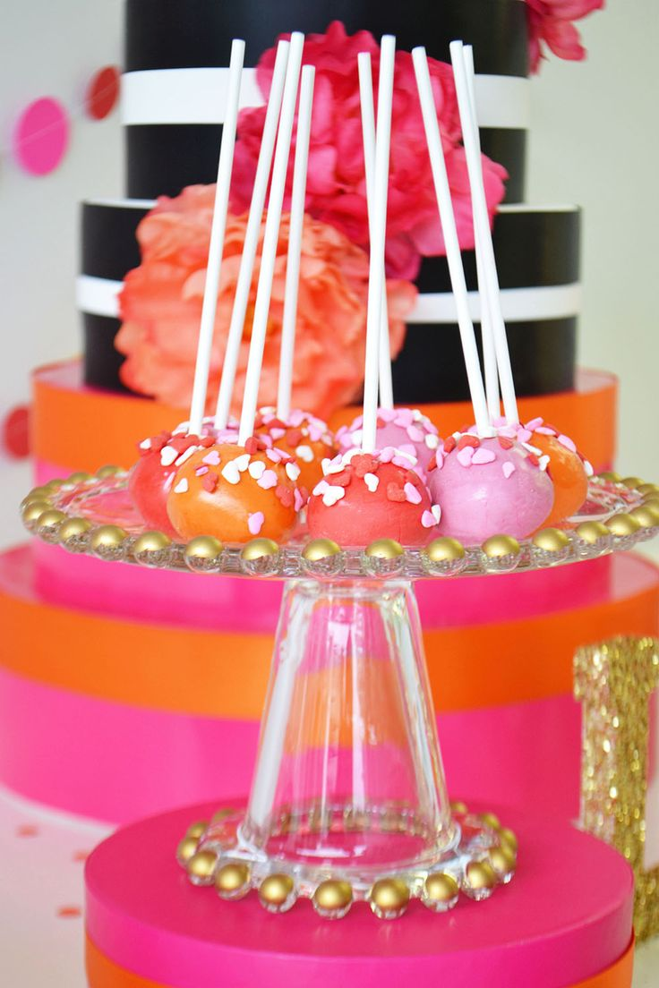Valentine's Cake Pops in red, orange and hot pink with heart sprinkles by Bake Sale Toronto.