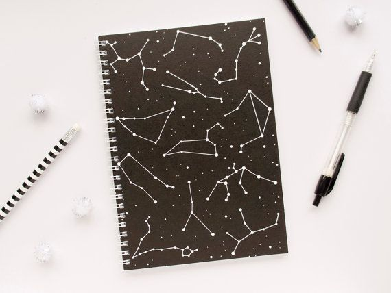 This notebook features the star sign constellations on a black background with speckled stars across the whole cover. DETAILS - Slightly