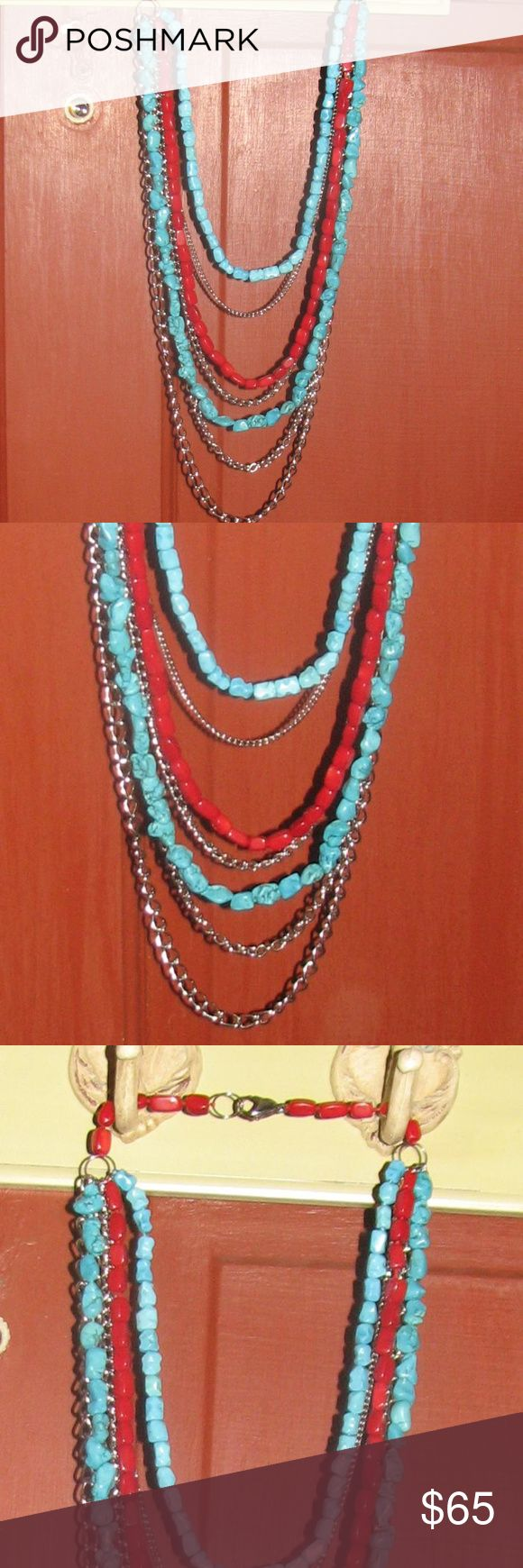 "TURQUOISE and RED CORAL Statement Necklace Almost new STATEMENT NECKLACE.   Two strands with turquoise, one with red coral, and four of stainless steel.  Only marking I could find on the clasp is ""Stainless Steel"", but I couldn't get a good enough picture of it.  Longest chain is approximately 30 inches, shortest is 20. Jewelry Necklaces"