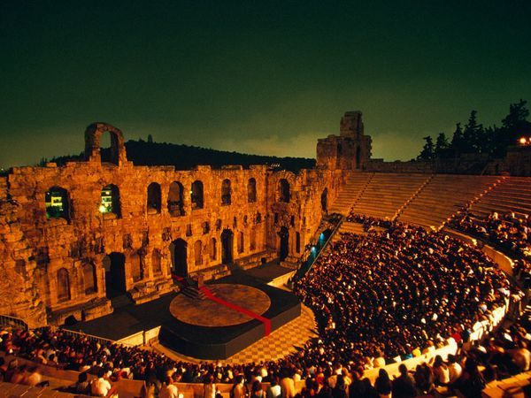 The Odeon of Herodes Atticus filled up with theatregoers before a late night summer performance. #Athens #Greece