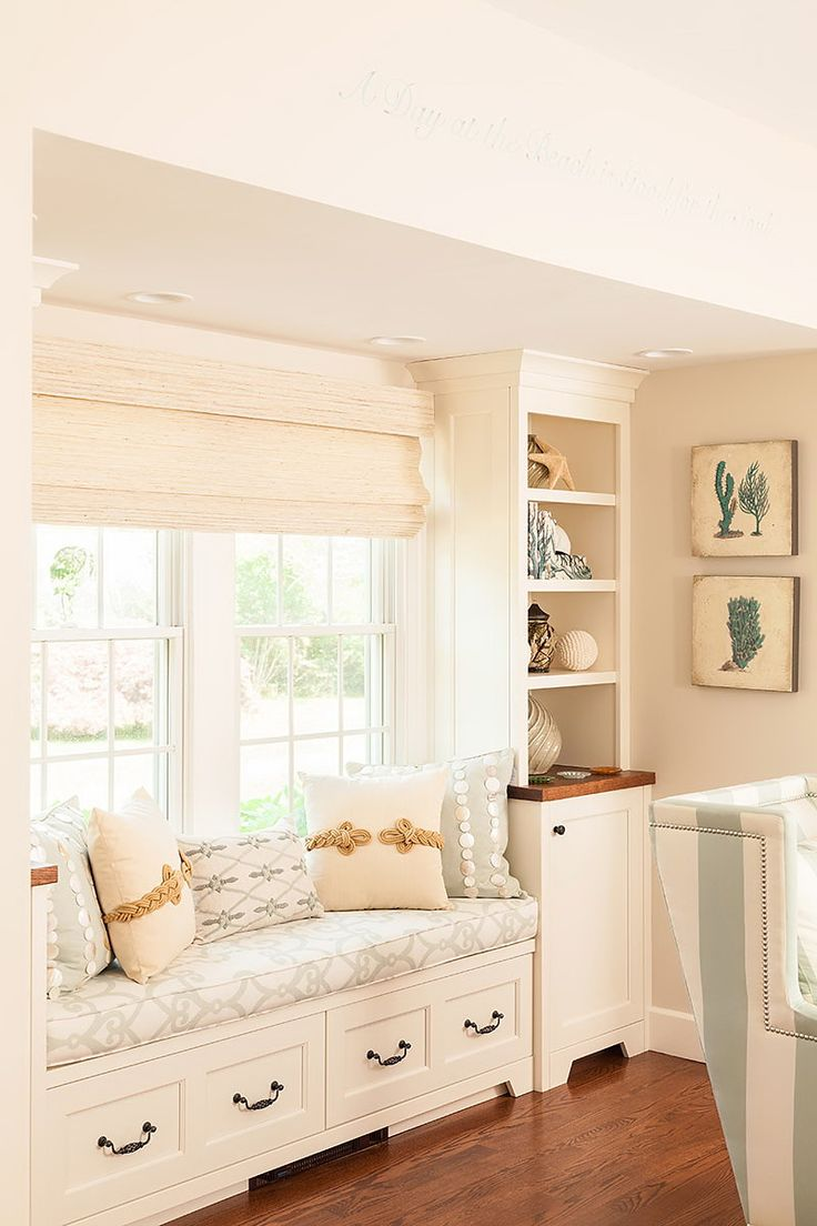 Pretty window seat with great pillows and side built ins!