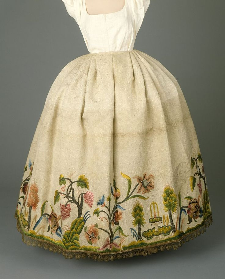 A woman's petticoat from Portugal, circa 1760. Made of silk and metallic thread embroidery on silk, with metallic bobbin lace (orris) along the bottom. See also: https://en.wikipedia.org/wiki/Arras_lace