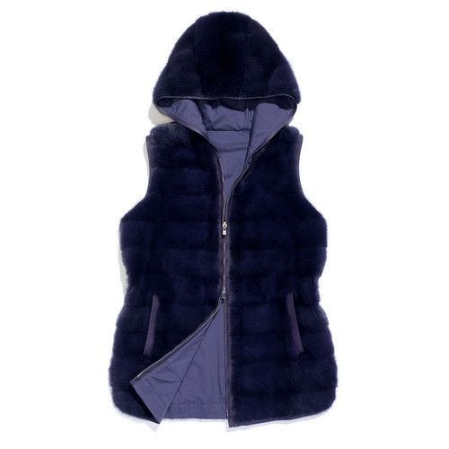 Reversible hooded vest in mink fur and stretch microfibre treated with Storm System®. Hip length, fitted style. Warm and effortlessly refined, this vest is designed to be worn as outerwear at the start of the season, teamed with a turtleneck, or slipped on under a coat or caban in the colder months.