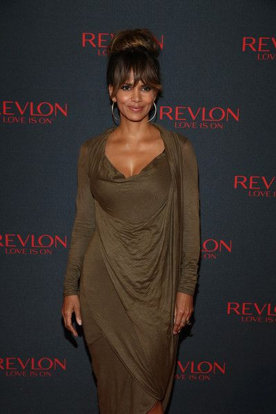 Halle Berry Photos Photos - Revlon Global Brand Ambassador Halle Berry celebrates the success of the Revlon LOVE IS ON Million Dollar Challenge at the Rainbow Room on November 18, 2015 in New York City. - Revlon LOVE IS ON Million Dollar Challenge