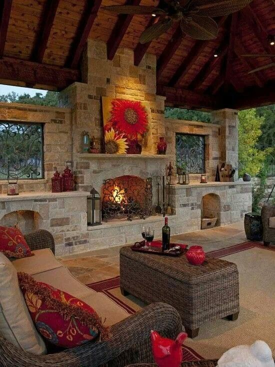Warm tones and smooth neutrals paired with a fireplace give this gorgeous outdoor living area a warm and inviting feel to it.