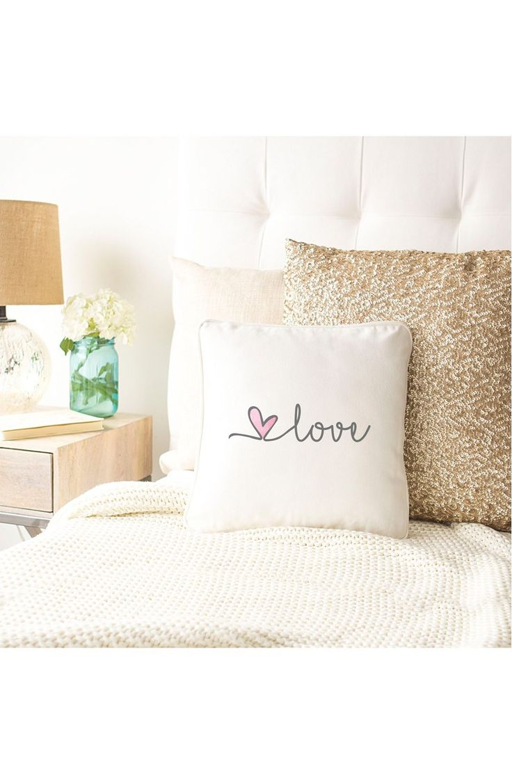 Adding a homey touch to the décor with this plush accent pillow stamped with elegant script.