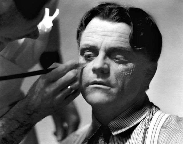 James Cagney is seen having black eye applied by makeup artist Perc Westmore on the set of The Strawberry Blonde, 1941.