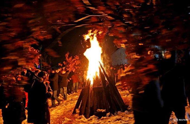 Bosnian Serbs carry oak and pray near burning Yule logs in front of the Church of the Holy Prophet Elijah during the eve of the Orthodox Christmas in Sokolac, Bosnia and Herzegovina, January 6, 2016. Most Orthodox Christians celebrate Christmas according to the Julian calendar on January 7, two weeks after most western Christian churches that abide by the Gregorian calendar. REUTERS/Dado Ruvic #orthodox #oak #fire #celebration #christmas #picoftheday #Gregorian #calendar #picoftheday