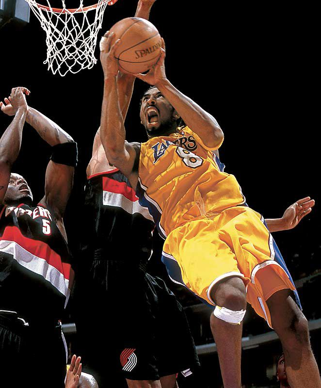 Kobe drives on Jermaine O'Neal and Detlef Schrempf during the 1999-2000 Western Conference Finals