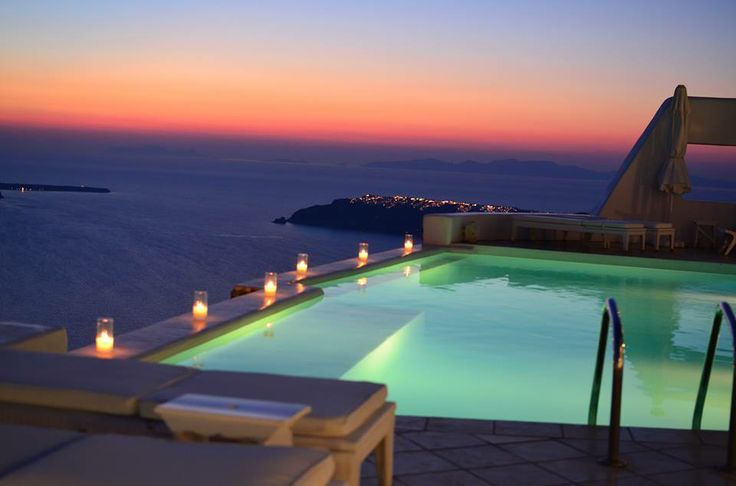 Feel a touch of romance and relaxation... be surrounded by Santorini's twinkling lights that reflect on the sparkling sea at night..! - Astra Suites Pool Bar, Santorini