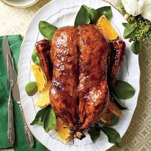 The Holiday Dinner Table | Classic Roasted Duck with Orange-Bourbon-Molasses Glaze | MyRecipes