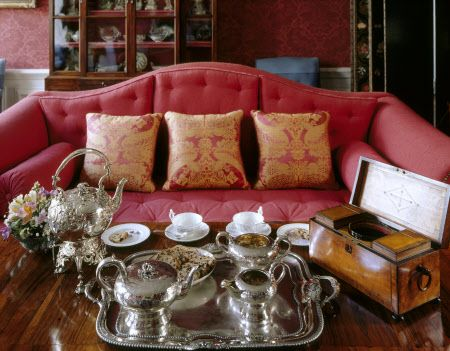 A silver tea-set laid out for afternoon tea in the Drawing Room at Mompesson House, Salisbury, Wiltshire
