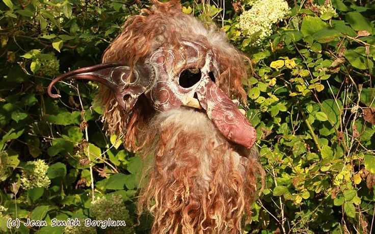 Une the Bone Troll - The troll mask is 100 % hand-made and hand-shaped of vegetable tanned leather. The other materials are grain color, acrylic paint, cow teeth, butyric acid tanned sheepskin, fox bone, clay beads and brass rings in the ears.