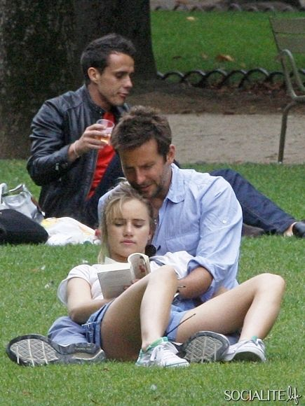 PARIS, FRANCE - Sunday August 25, 2013. Bradley Cooper and his model girlfriend Suki Waterhouse share a romantic afternoon in the park in Paris.