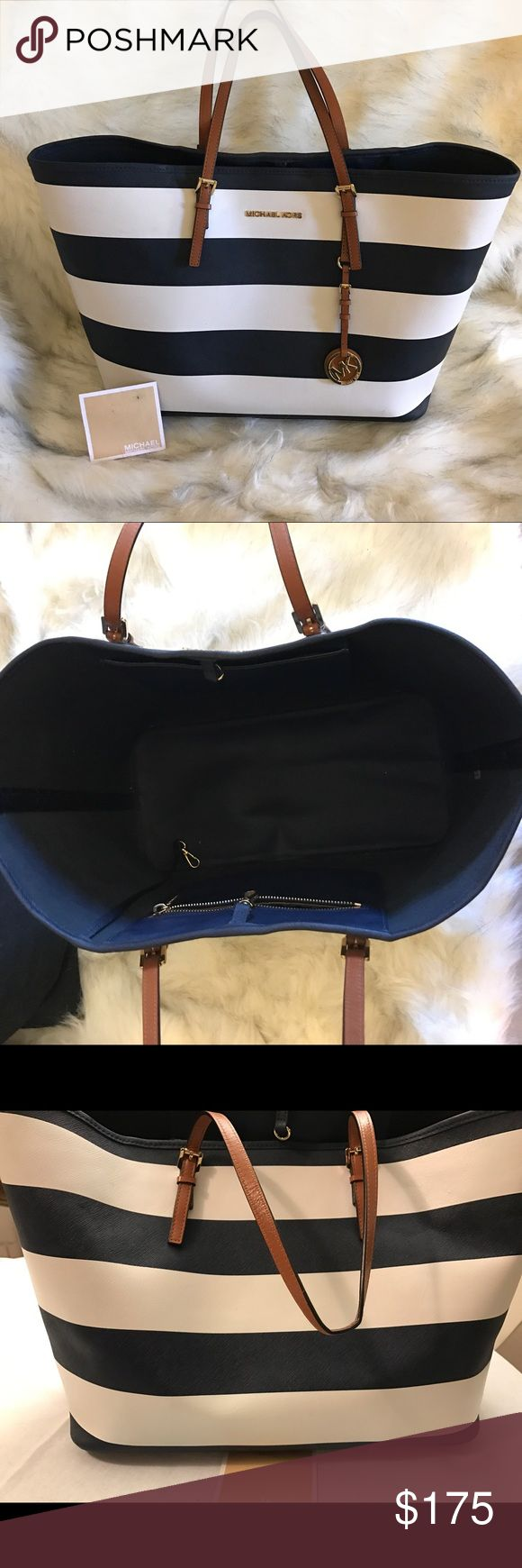 Michael Kors Jet Set striped Tote Bag Authentic Michael Kors Jet Set Navy and White large Tote bag. Brown leather straps and gold tone hardware. Gently used bought in 2013. Great condition Michael Kors Bags Totes