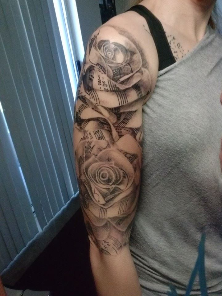 women half sleeve tattoo  roses and music Black and white realism