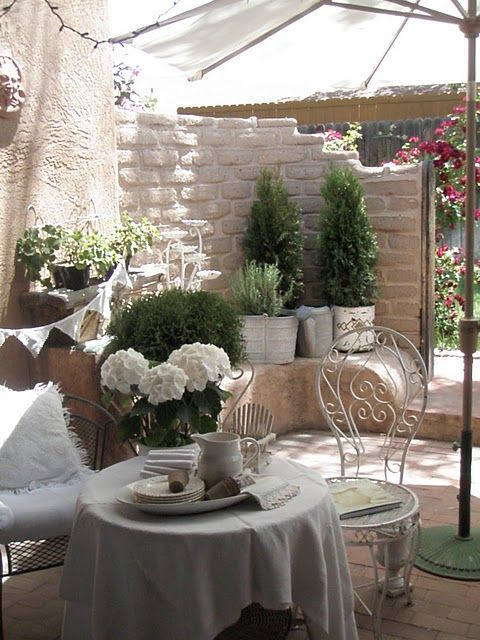 Gorgeous outdoor spot! How about on that patio outside a bedroom with French door exit.