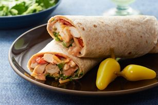 Chicken Fajita Roll-Ups recipe - Chicken, cheese and fresh veggies rolled into a whole wheat tortilla bring a little sizzle to your table. Chunky salsa gives this low-cal wrap a kick. #HealthyLivingRecipes