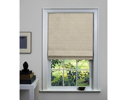 shade store This oatmeal Roman shade is 97 percent linen and 3 percent cotton. It is available with a blackout liner to keep the bedroom dark.